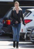 Rosie Huntington-Whiteley is accompanied by a friend as she pays a visit to Saint John hospital in Santa Monica, California