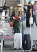 Sabrina Carpenter is seen carting her luggage at LAX Airport in Los Angeles