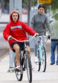 Selena Gomez and Justin Bieber out riding bikes in Los Angeles