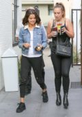 Selena Gomez grabs a fresh pressed juice with a friend at Alfred's Coffee in Los Angeles