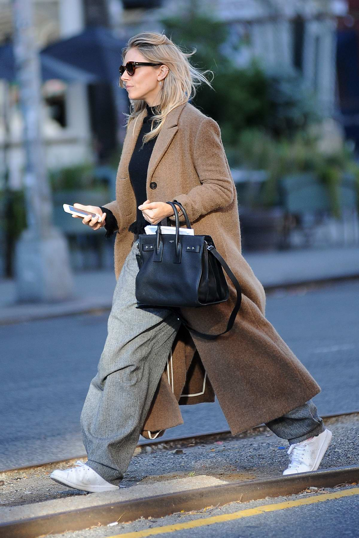 Sienna Miller in a overcoat spotted running errands in New York City