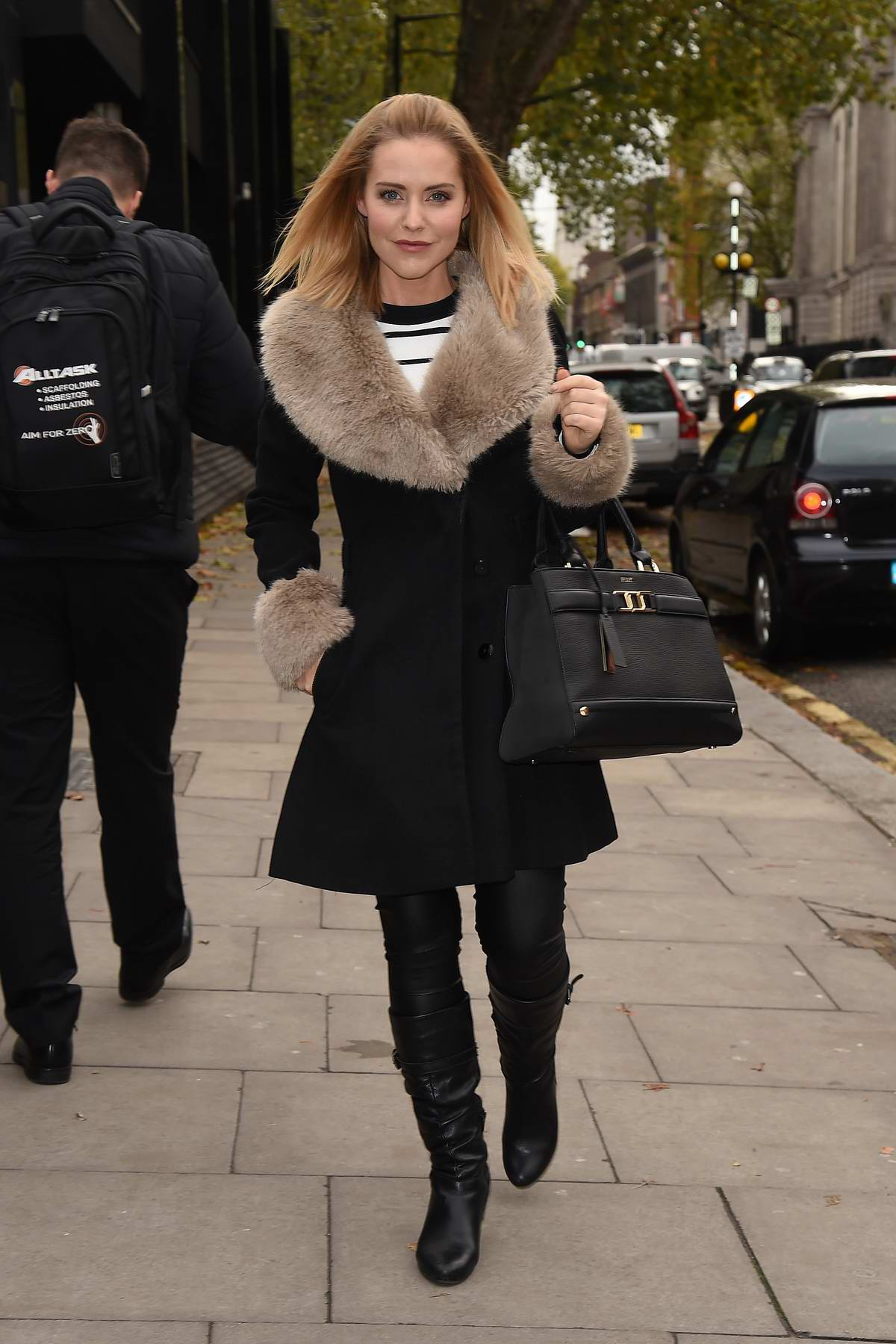 Stephanie Waring is seen out and about wearing a black coat with a fur collar in London