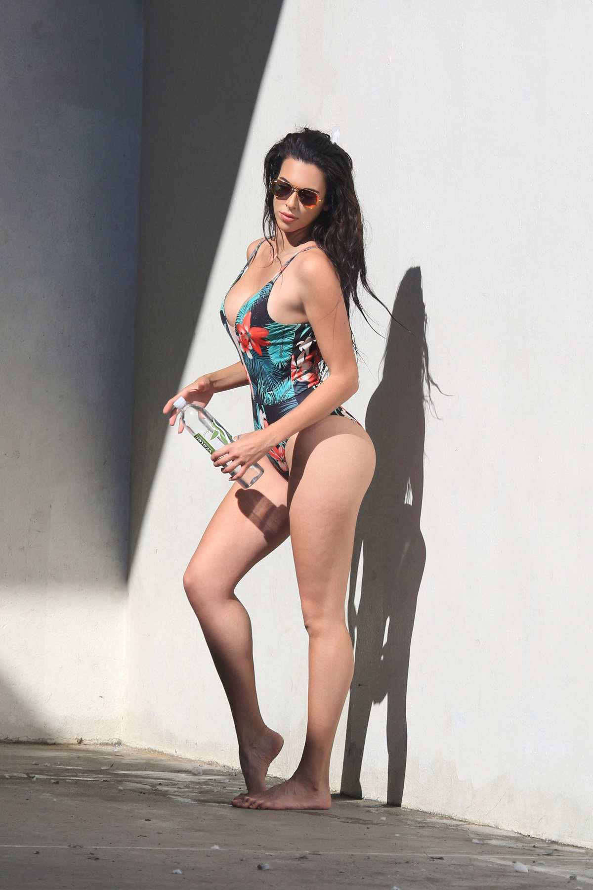 Tania Marie in Versace swimsuit as she shoots for 138 water in Venice beach, Los Angeles