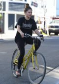 Thylane Blondeau goes for a bicycle ride with her friend in Venice, California