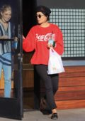 Vanessa Hudgens in a red coca cola sweatshirt leaving a cafe in Los Angeles