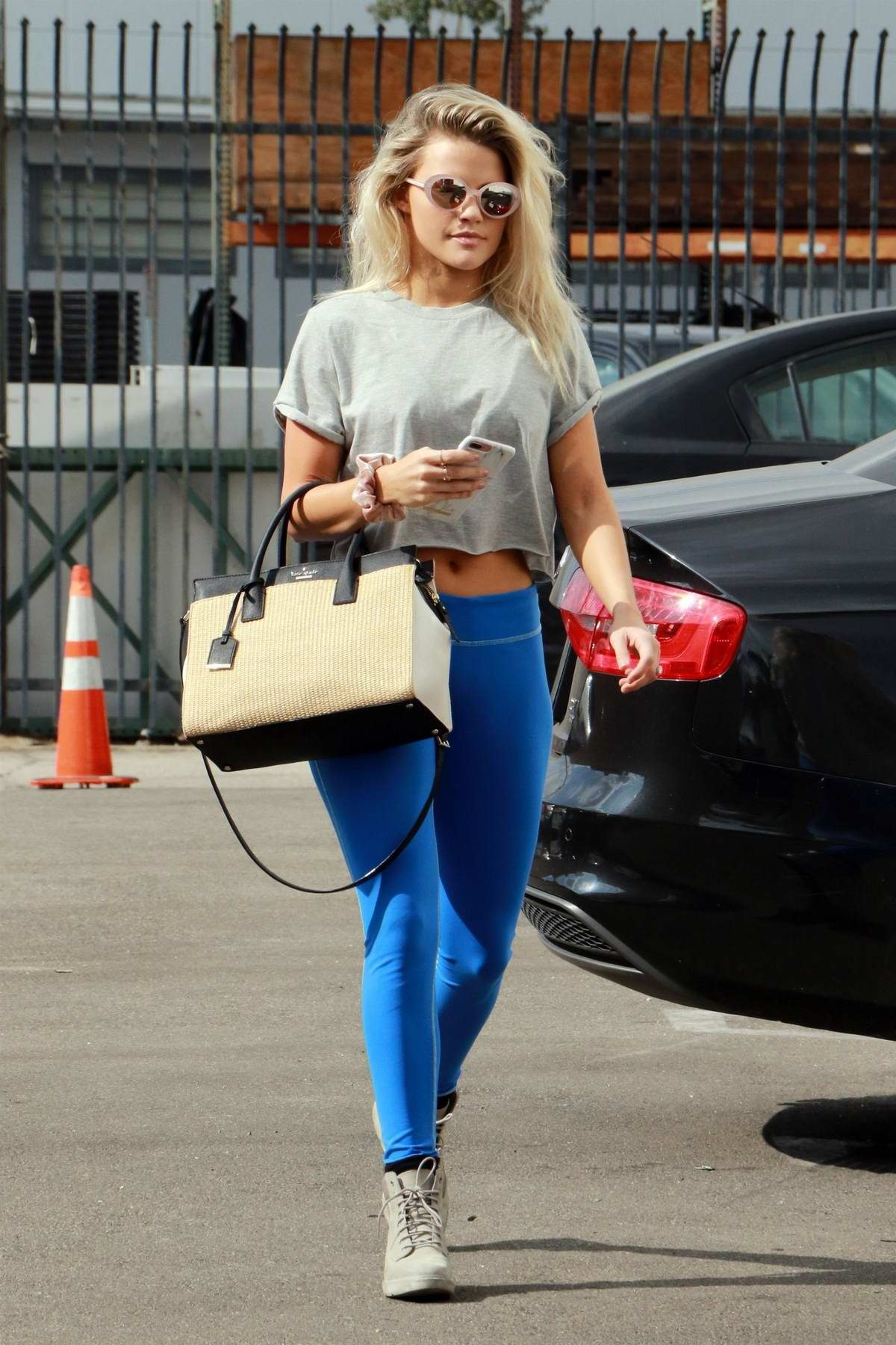 Witney Carson dressed in a bright blue leggings, heading to the dance practice in Los Angeles