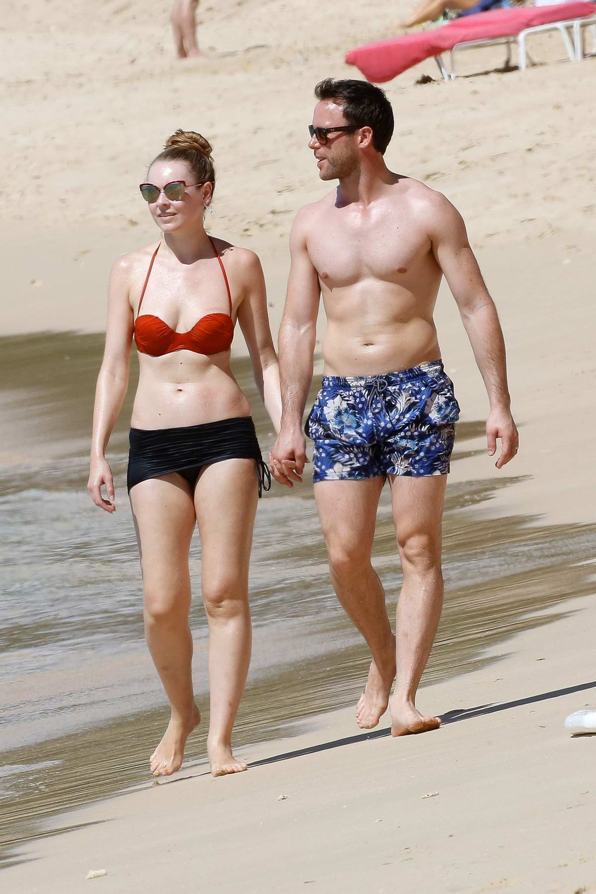 Zoe Salmon in a red and black bikini enjoying a holiday with her husband in Barbados