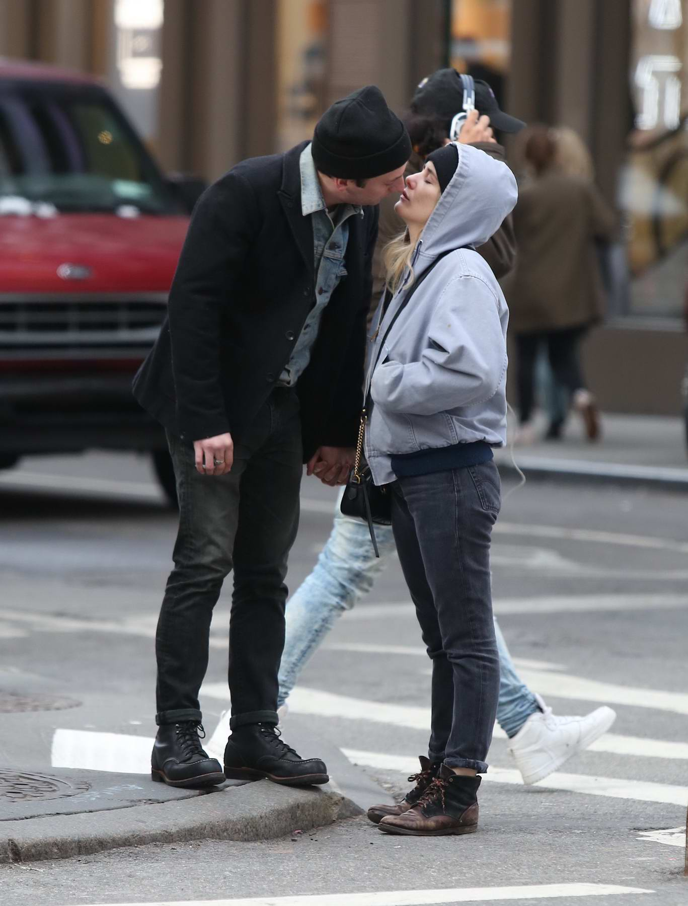 Addison Timlin and Jeremy Allen White share a kiss while shopping in SoHo, New York City