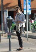 Alessandra Ambrosio feeds the parking meter as she head to the gym in Los Angeles