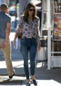 Alessandra Ambrosio wearing a floral shirt and skinny jeans while out shopping with a friend in Beverly Hills, Los Angeles