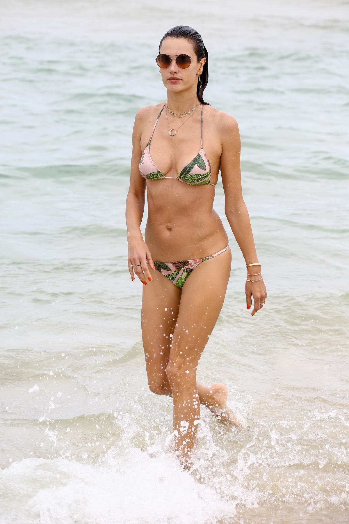 Alessandra Ambrosio wears a pink string bikini as she continues her vacation at the beach in Florianopolis, Brazil