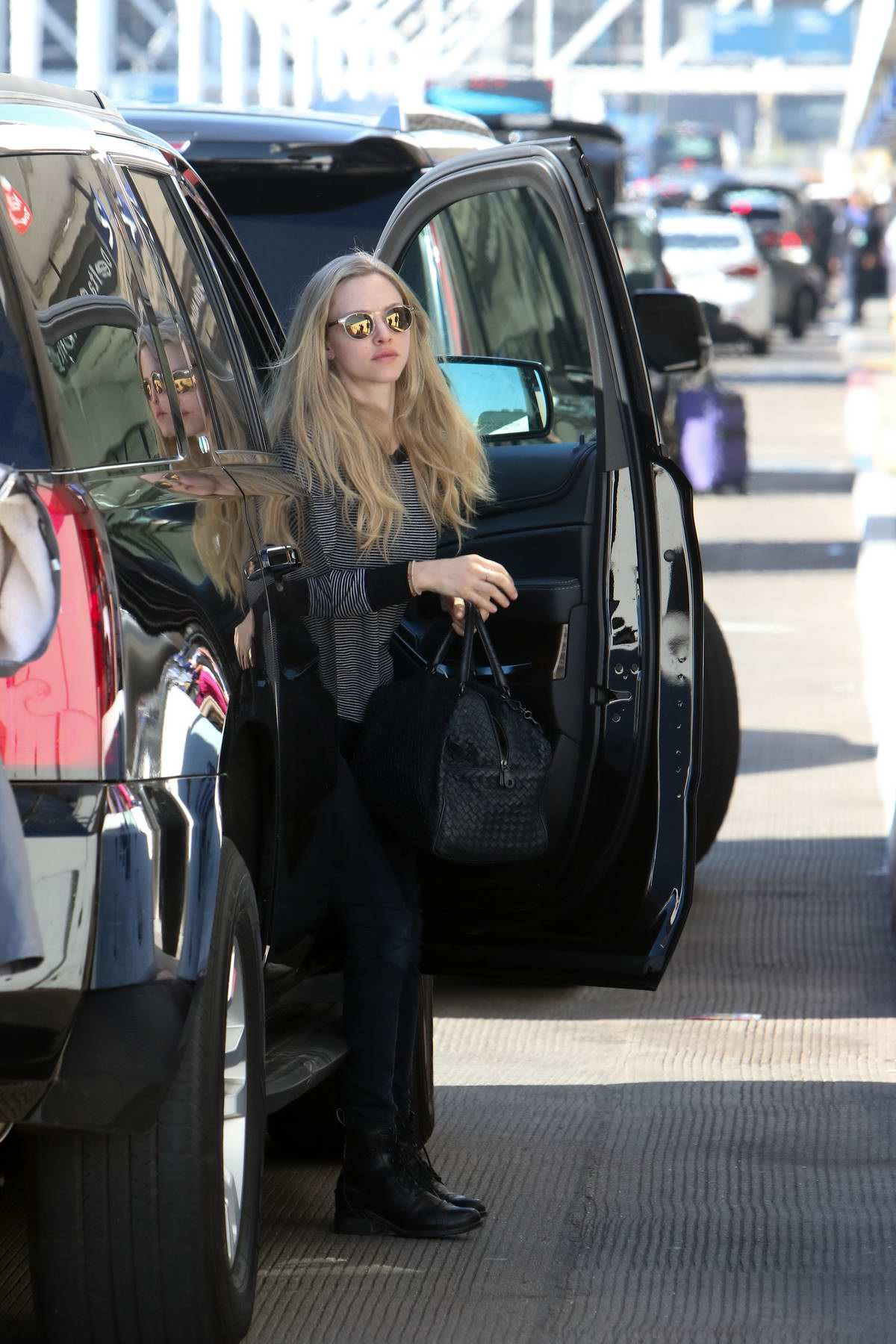 Amanda Seyfried arrives at LAX airport to fly out of Los Angeles for a family holiday