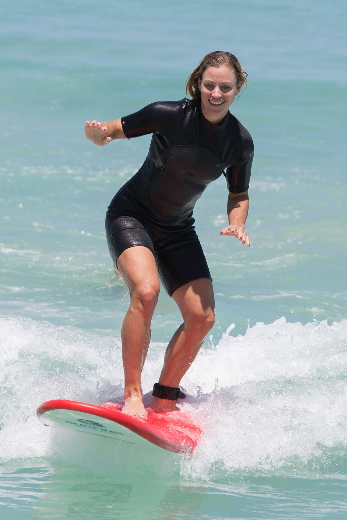 Angelique Kerber appears to be taking some surfing lesson at Trigg beach in Perth, Australia