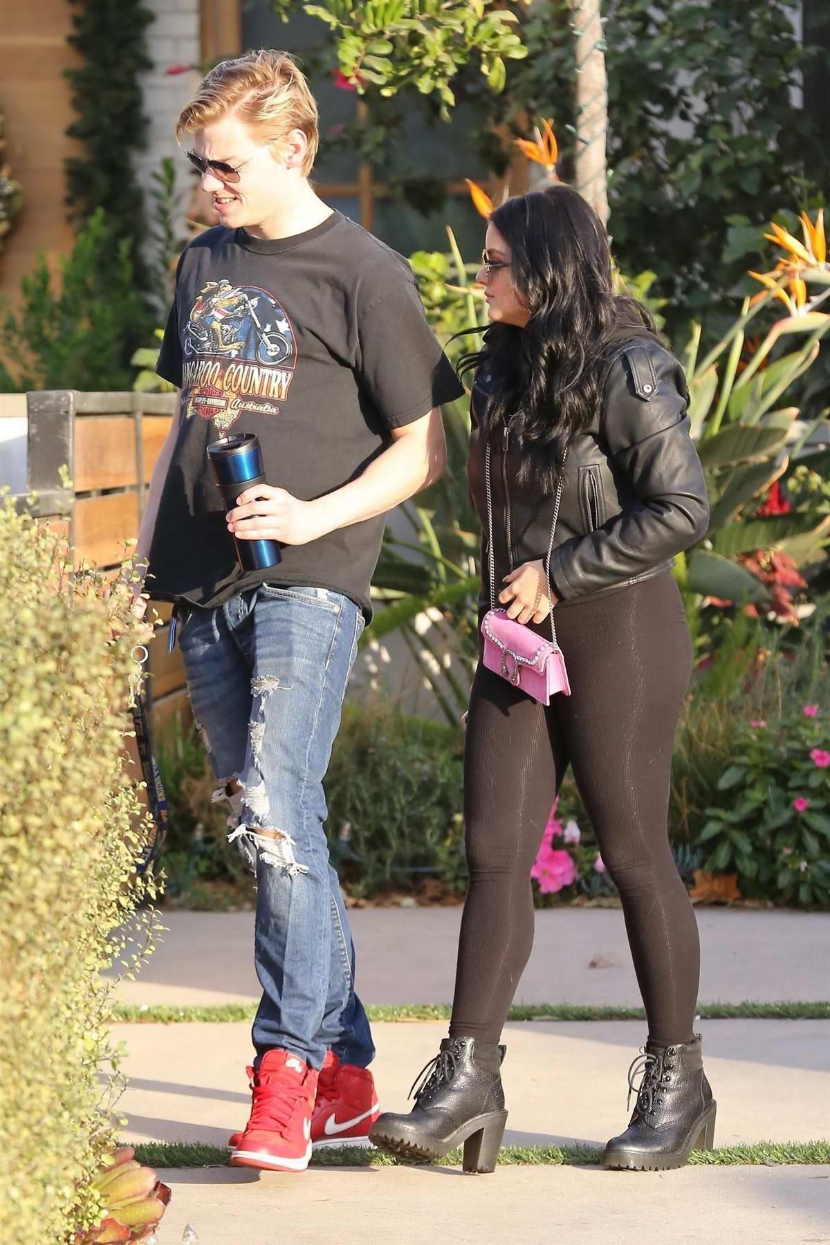 Ariel Winter dressed in all black stop by a friends house with boyfriend Levi Meaden in Studio City, Los Angeles