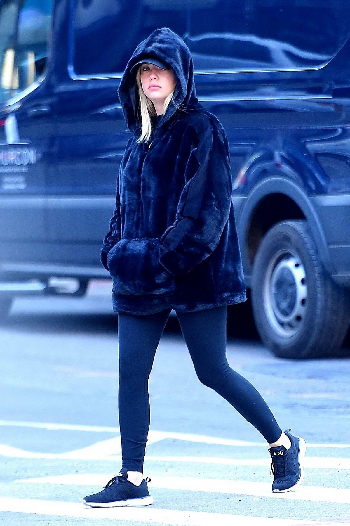 Ashley Benson bundles up with her hoodie jacket on her way to the gym for her workout in New York