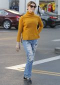 Ashley Greene in a yellow turtleneck and ripped jeans does grocery shopping at Bristol Farms in Beverly Hills, Los Angeles