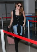Ashley Greene spotted at LAX airport as she skips town with fiance Paul Khoury