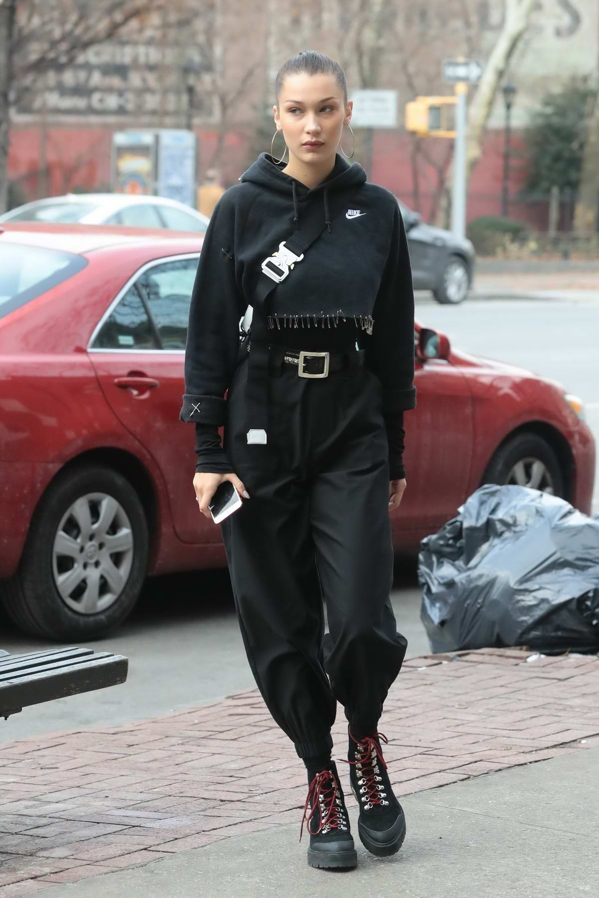 Bella Hadid rocks an all black Nike ninja outfit as she heads to Bar Pitti with friends in New York