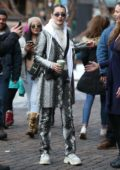 Bella Hadid wears a snake-skin outfit while out with her friends in Aspen, Colorado