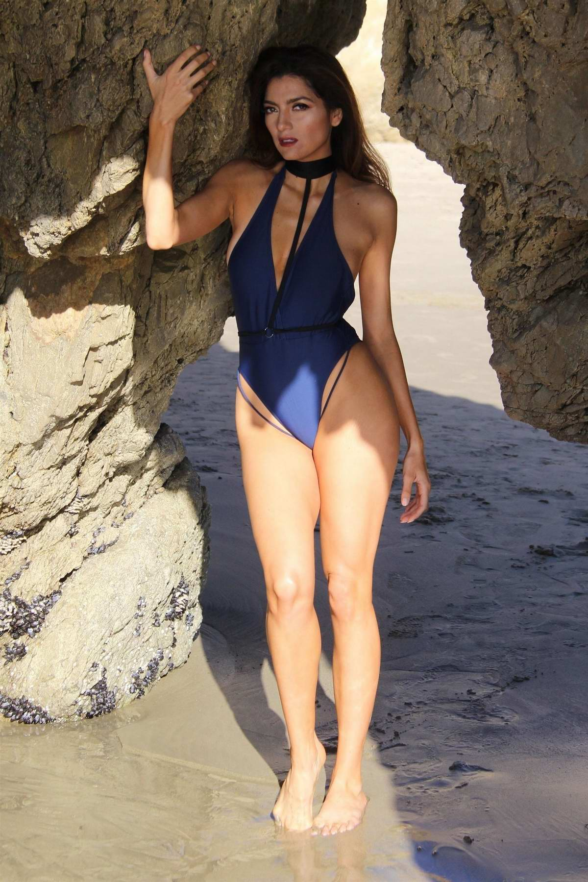 Blanca Blanco posing in a blue swimsuit during a photoshoot on the beach in Malibu, California
