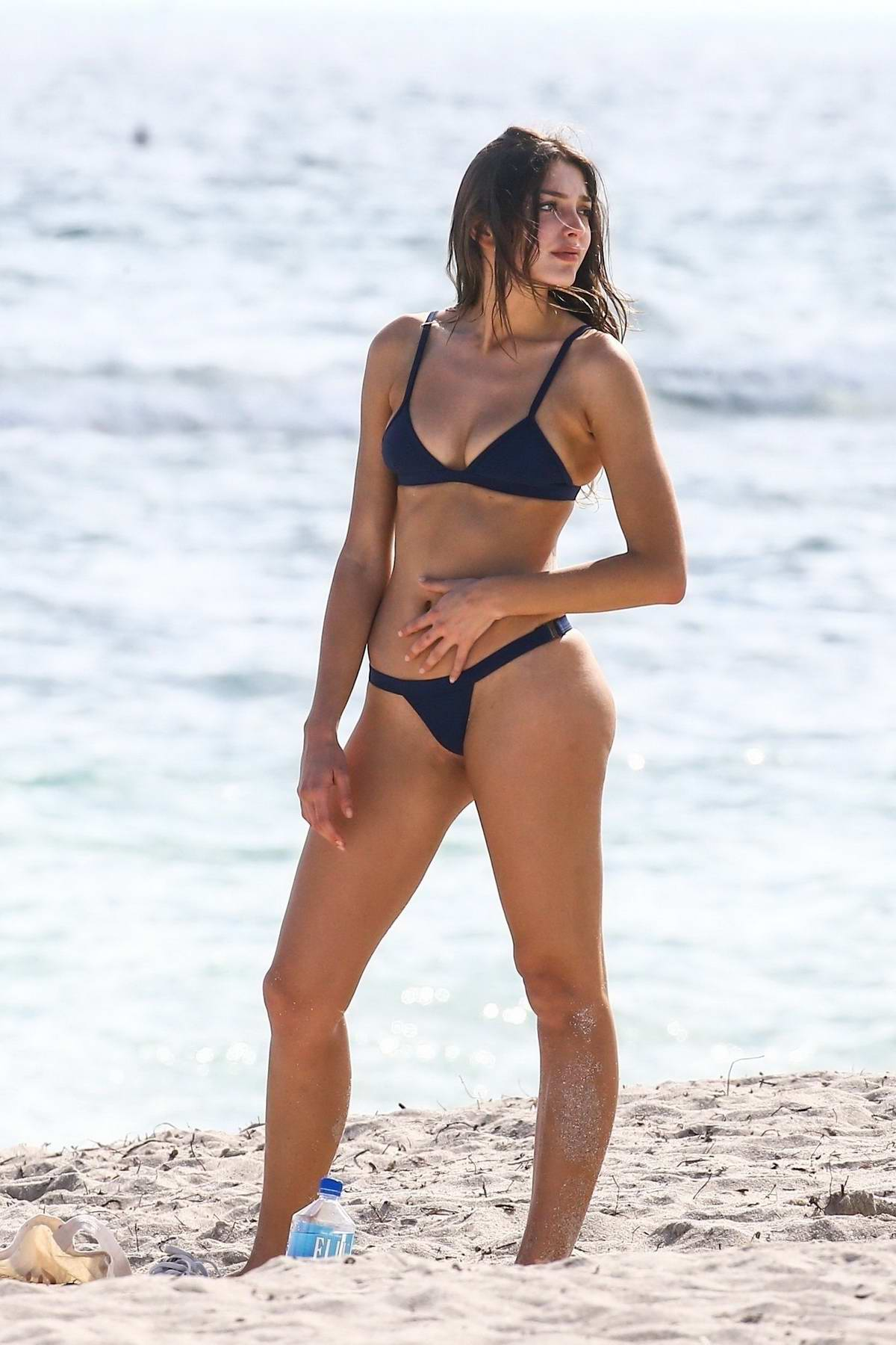 Celine Farach wearing a black bikini as she spends a day with her boyfriend at beach in Miami, Florida