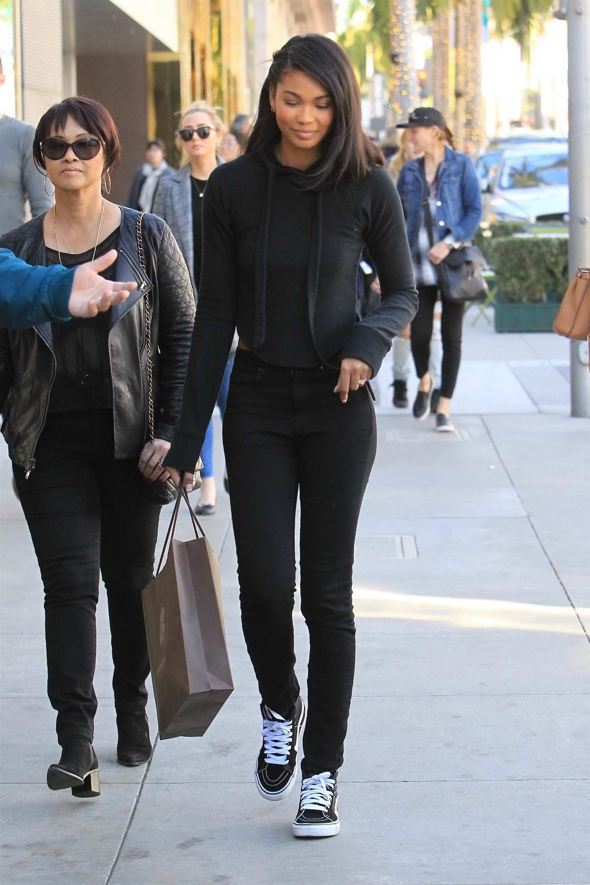 Chanel Iman flashed her new engagement ring while out doing some last-minute holiday shopping with her mom in Beverly Hills, Los Angeles