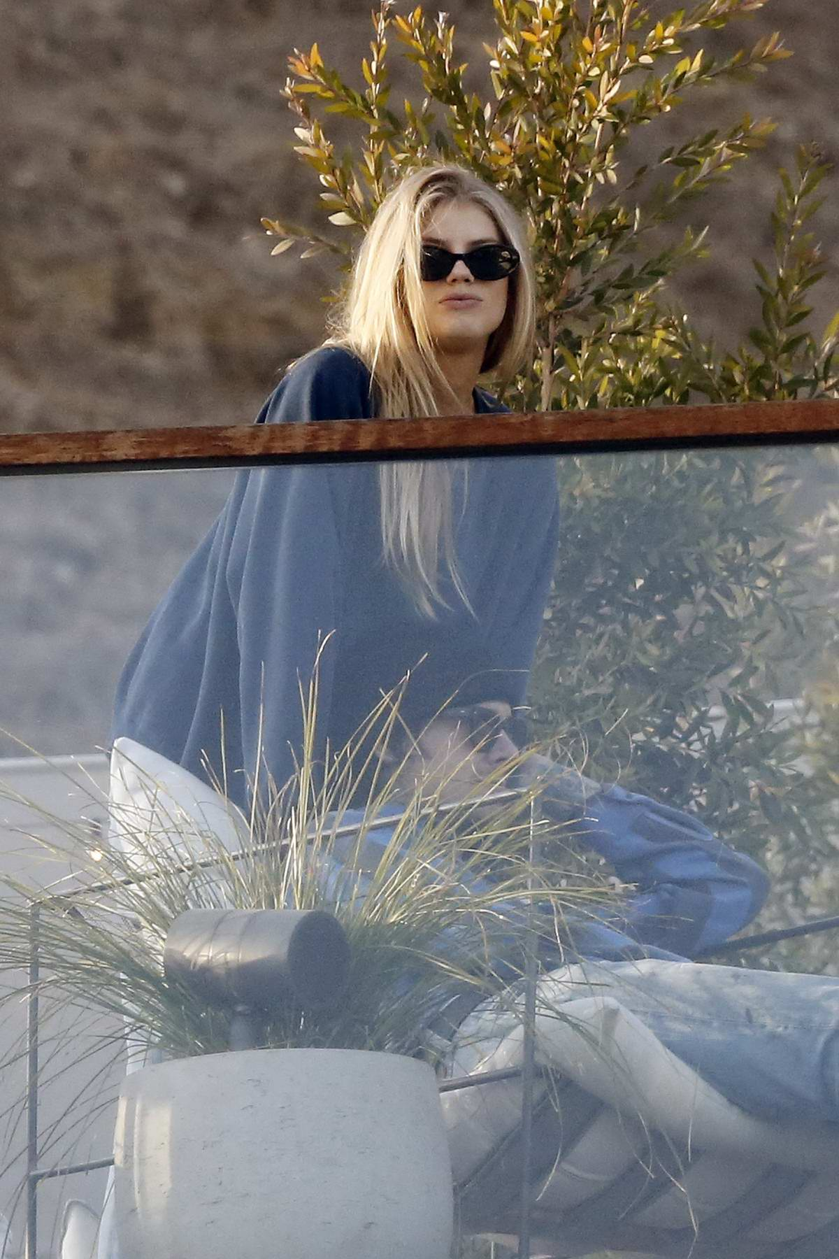 Charlotte McKinney looked cozy with her new boyfriend as they hangout in Malibu, California