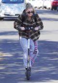 Charlotte McKinney rides a Bird scooter around Santa Monica, California