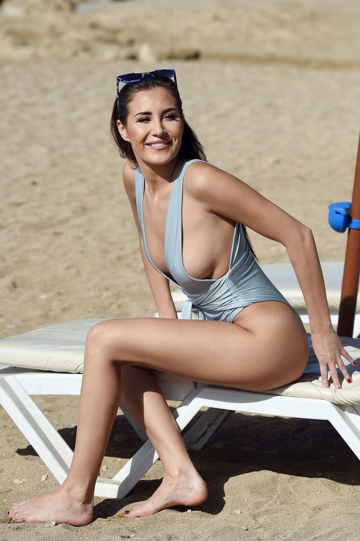 Chloe Goodman sports a light blue swimsuit as she relax on the beach in Cape Verde
