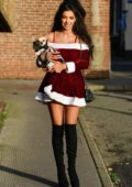 Chloe Khan wearing Santa dress while out with her dog in Liverpool, UK
