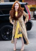 Christina Hendricks wearing a fur lapel leopard print coat as she arrives at an office building in New York City