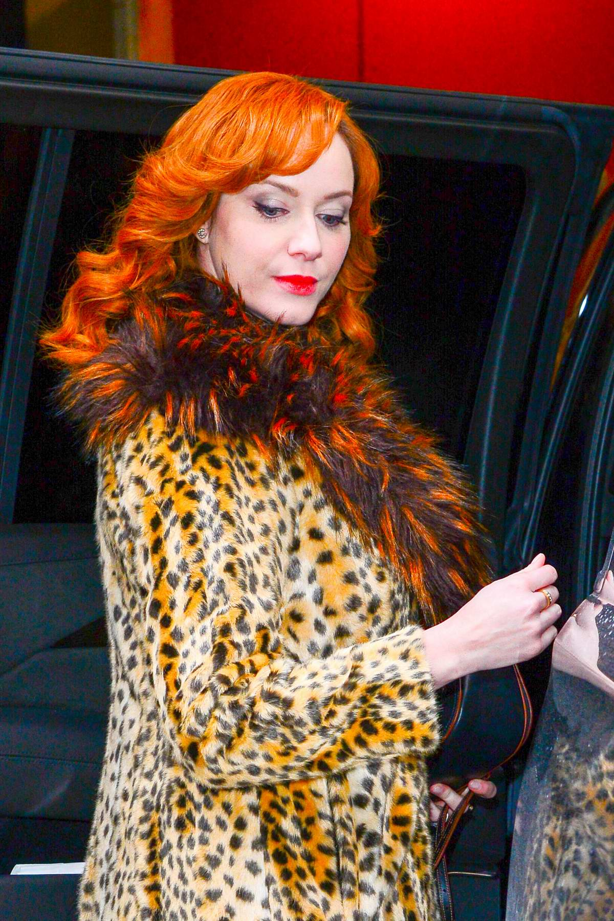 80bddaf3e04f christina hendricks wearing a fur lapel leopard print coat as she arrives  at an office building in new york city-131217_5