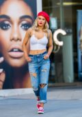 CJ 'Lana' Perry sports a red cap with white cropped tank top and ripped jeans while leaving a hair salon in Los Angeles