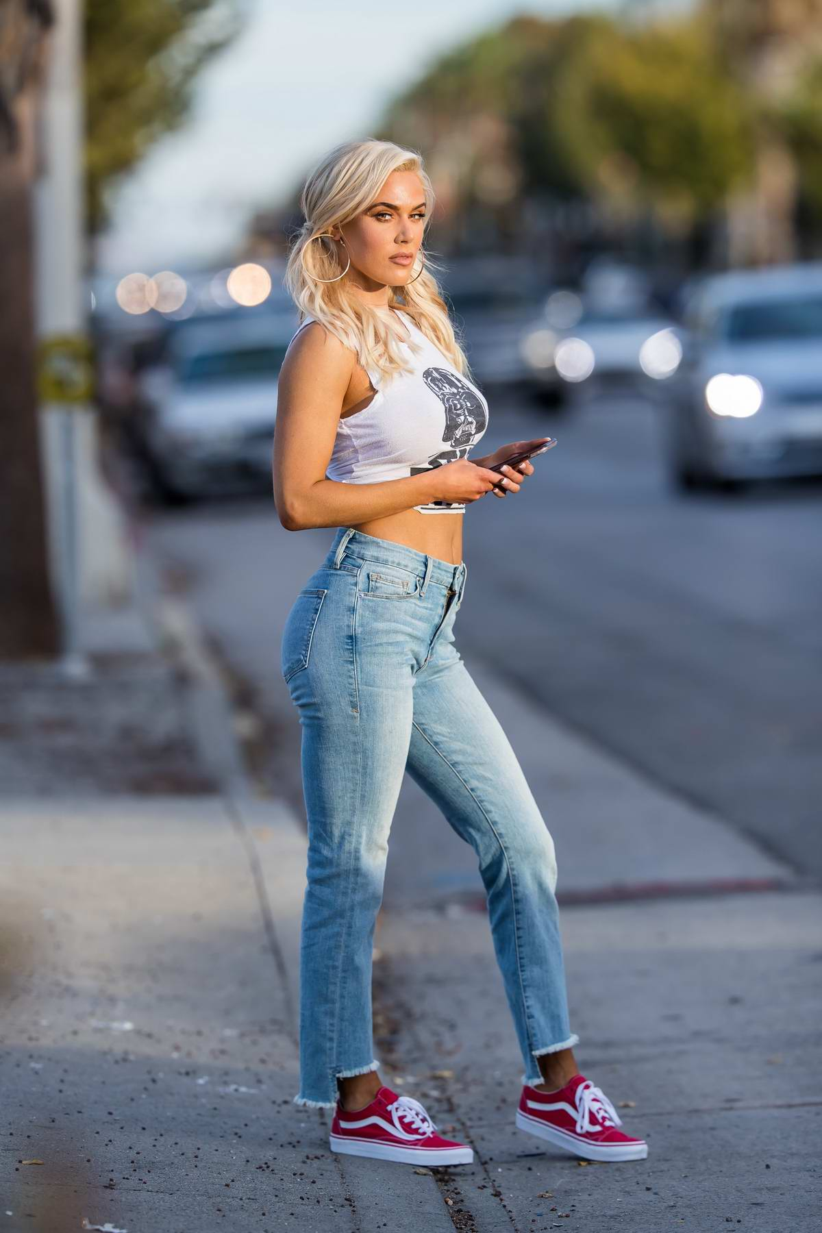 CJ 'Lana' Perry wearing a tight fit 'Star Wars' cropped vest top and jeans while out in Los Angeles