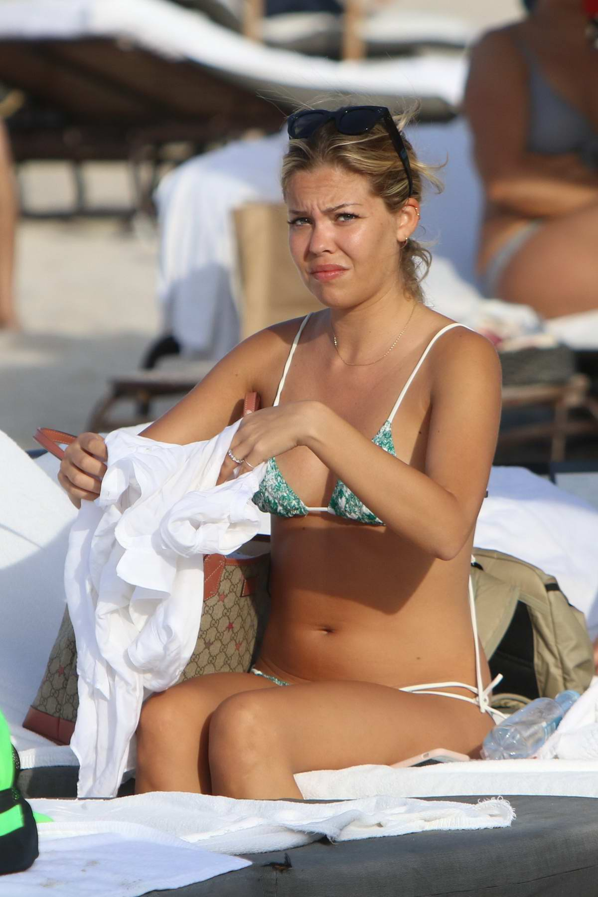 Constance Caracciolo in a bikini enjoying the sun at the beach in Miami, Florida