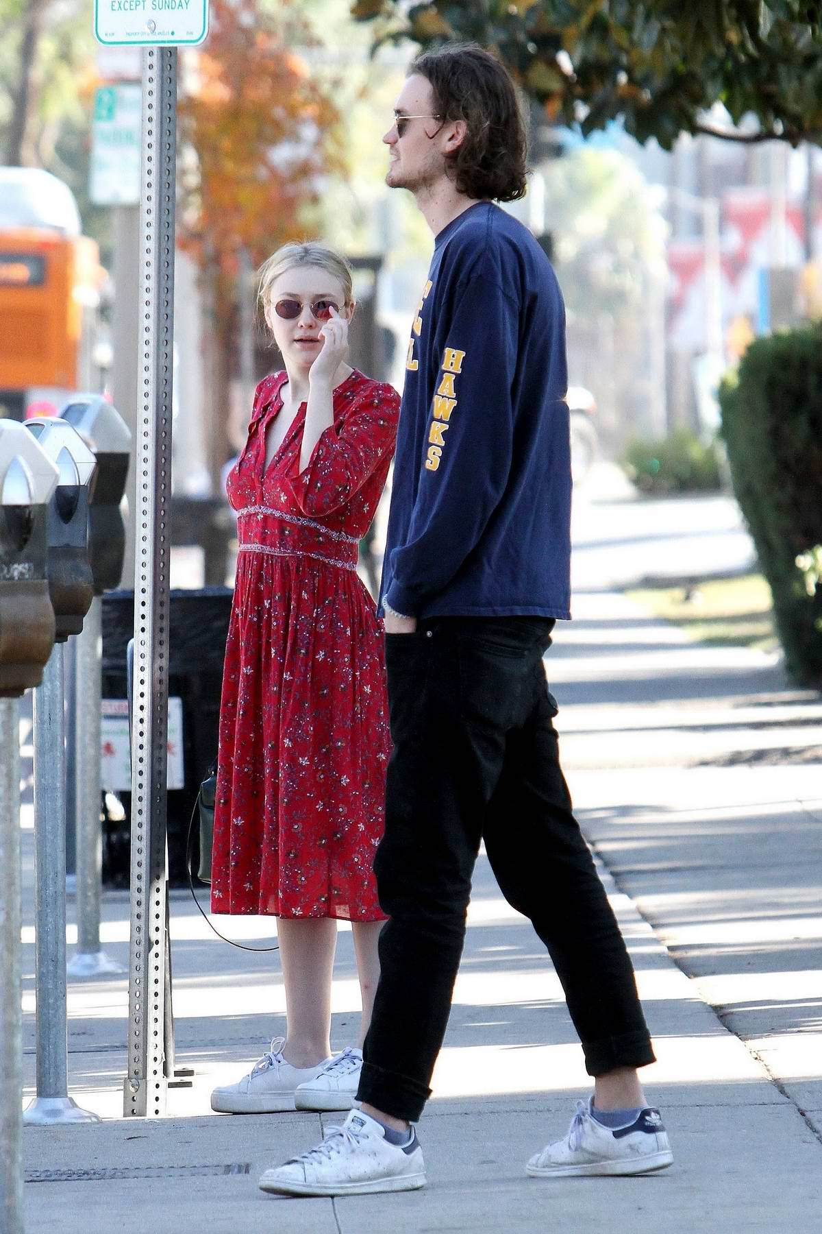 Dakota Fanning and boyfriend Henry Frye spotted leaving a family lunch in Studio City, Los Angeles