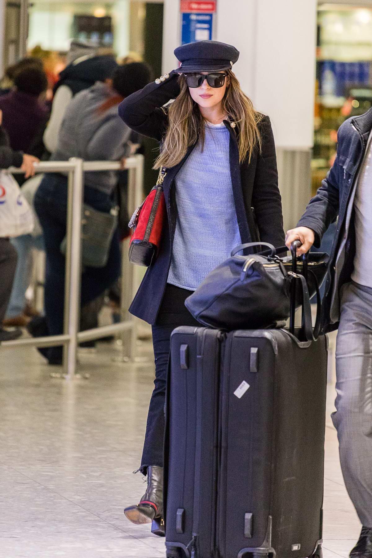 Dakota Johnson arrives at Heathrow airport in London