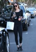 Dakota Johnson stops by Alfred Coffee in West Hollywood, Los Angeles