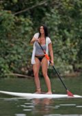 Darcie Lincoln goes paddle-boarding with boyfriend Jeremy Piven while on vacation in Hawaii