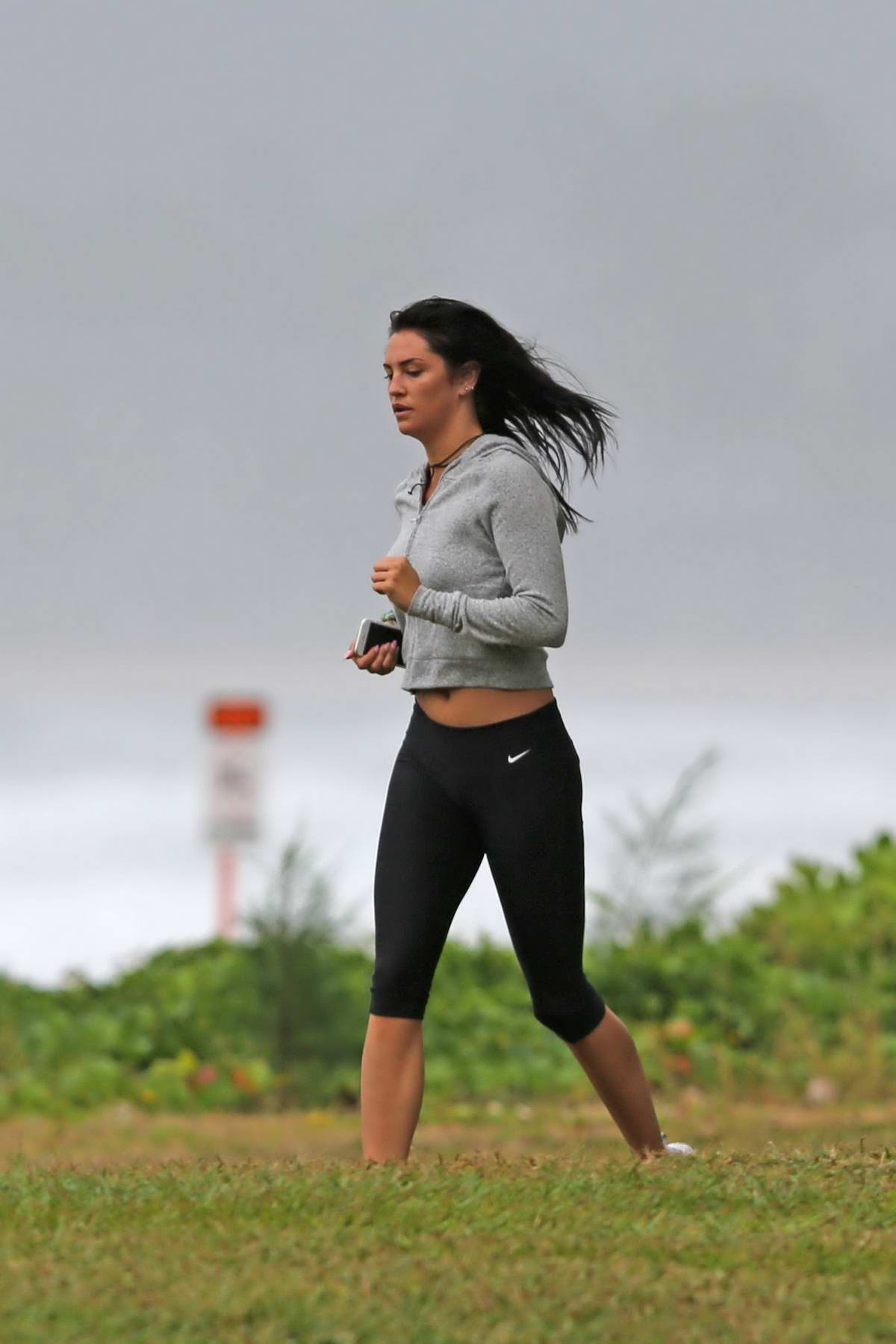 Darcie Lincoln out for a run along the beach while on vacation in Hawaii
