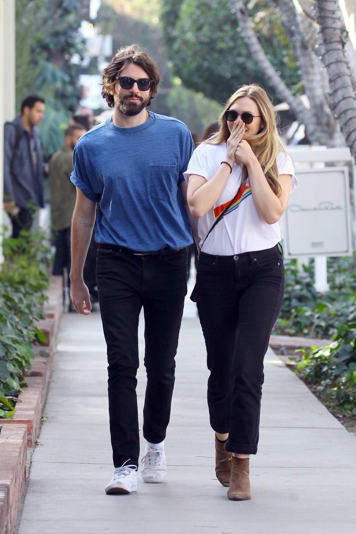 Elizabeth Olsen and boyfriend Robbie Arnett enjoy some ice cream while they shop at The Grove in Los Angeles