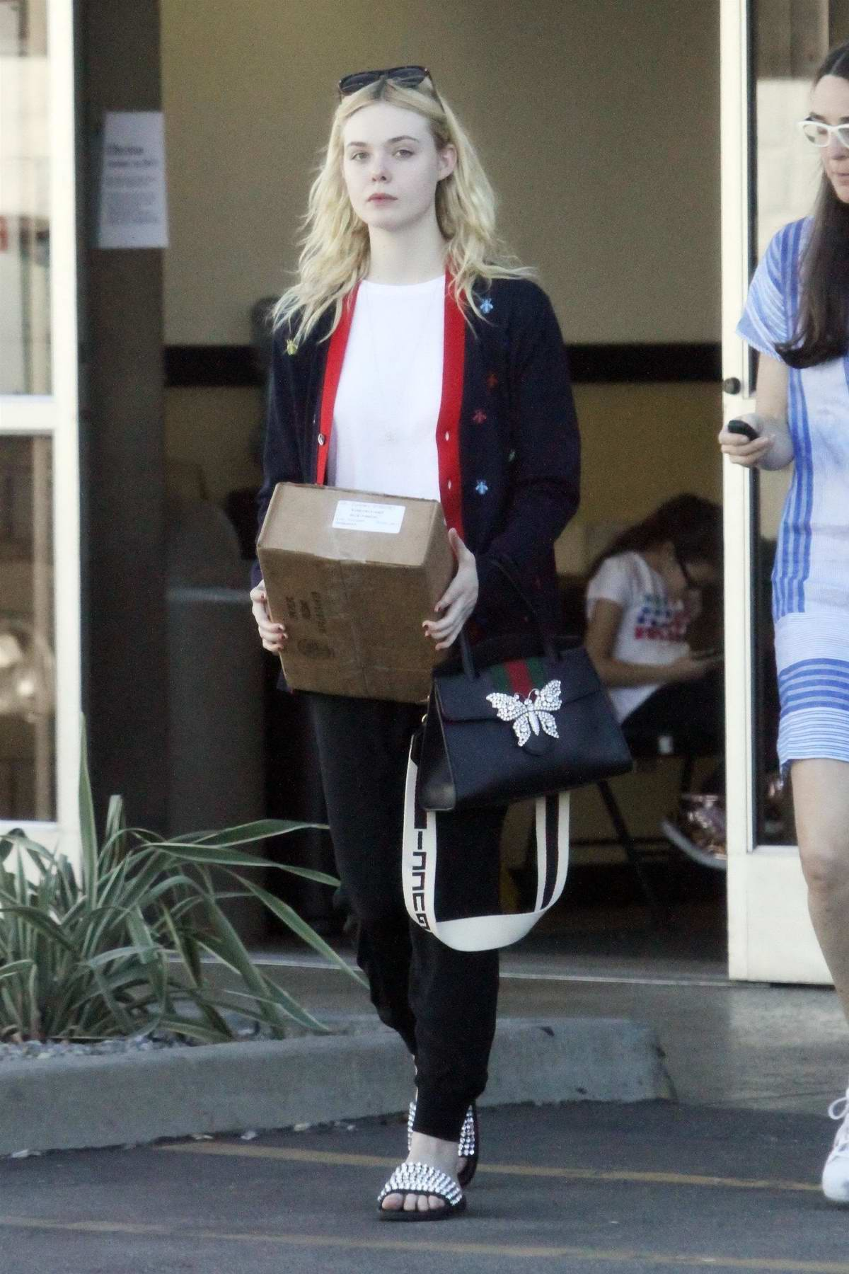 Elle Fanning and her mother stop by a UPS store to pick up a package in Studio City, Los Angeles