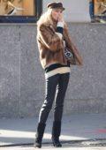 Elsa Hosk having a smoke while running errands in New York City