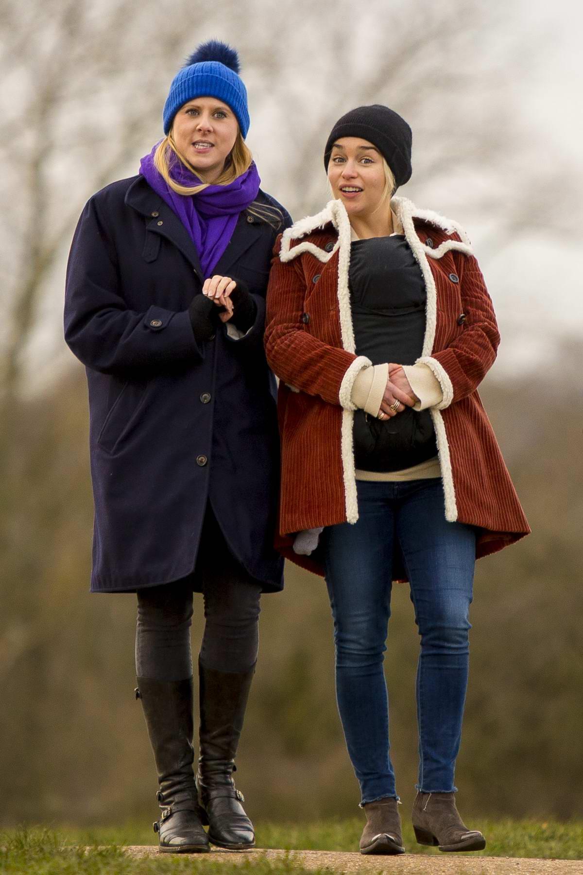 Emilia Clarke enjoys a walk with her newborn godson around Hampstead Heath in London