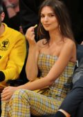 Emily Ratajkowski wears a yellow plaid jumpsuit at the Houston Rockets vs LA Lakers game in Los Angeles