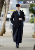 Emma Stone keeps a low profile as she headed into a hotel in Los Angeles