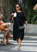Eva Longoria spotted wearing a black dress as she walk around with some friends after lunch in Miami beach, Florida