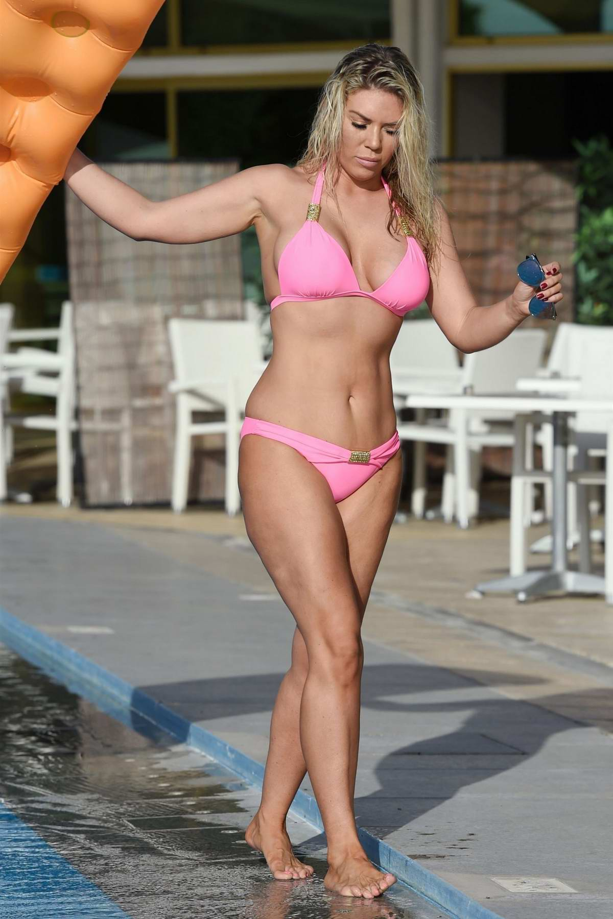 Frankie Essex in a pink bikini relaxing at the pool in Cape Verde