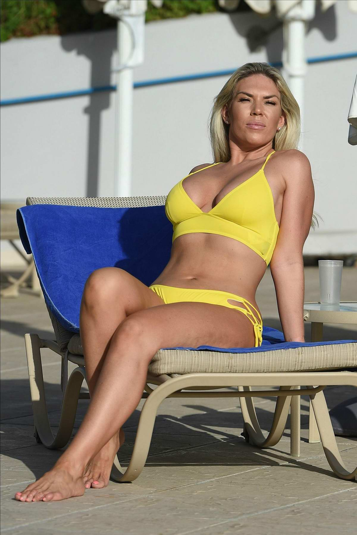 Frankie Essex wearing a yellow bikini while enjoying a winter holiday in Cape Verde