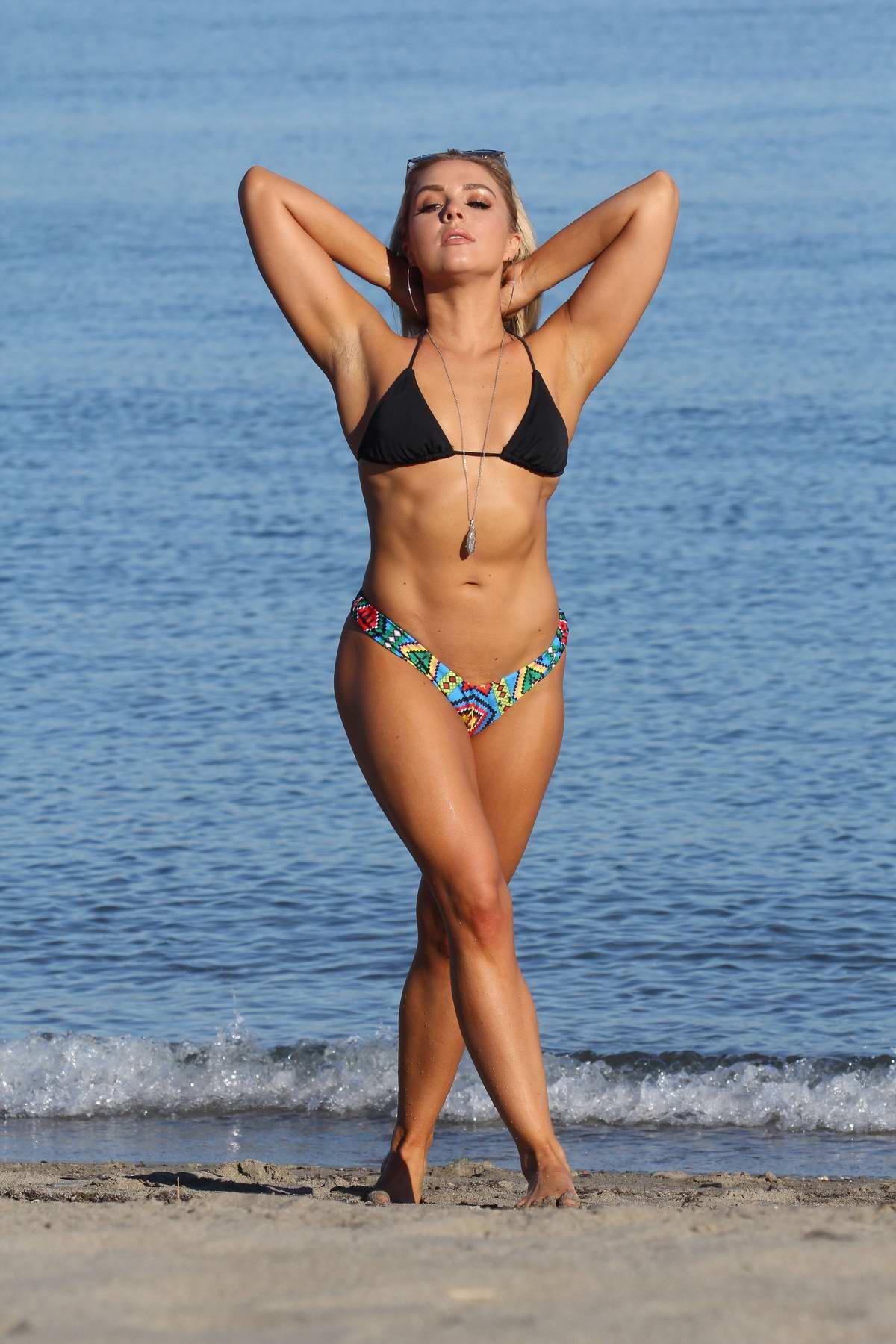Gabby Allen in bikini enjoying the beach whilst on holiday in Marbella, Spain